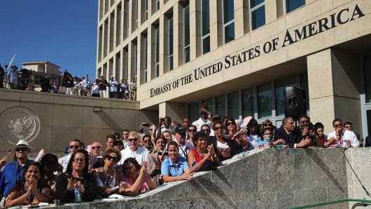 Employees and guests of the newly reopened U.S. Embassy attend the flag-raising ceremony August 14, 2015 in Havana, Cuba.