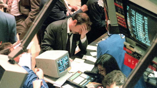 A trader on the New York Stock Exchange holds his head in October 1987 as stocks were devastated during one of the most frantic days in the exchange's history.