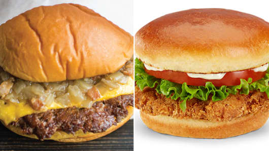 Shake Shack Roadside Shack burger, left, and a McDonald's premium buttermilk crispy chicken deluxe sandwich