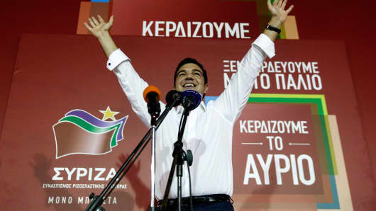 Alexis Tsipras, Greece's incoming prime minister and leader of the Syriza party, celebrates as he secures victory in the general election in Athens on Sunday.