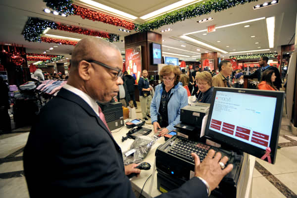 Shoppers pay for items at a Macy's store in New York.