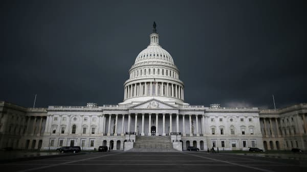 Storm clouds fill the sky over the U.S. Capitol Building in Washington, DC.
