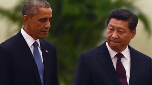 President Barack Obama walks with Chinese President Xi Jinping at a welcome ceremony in the Great Hall of the People in Beijing on Nov. 12, 2014.