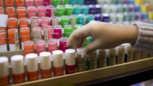 A customer browses nail polish at Amorepacific Corp.'s Innisfree store.