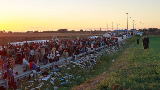 Migrants wait in a holding area across from the Croatian border after walking the last few kilometers from Serbia to Croatia on September 21, 2015.