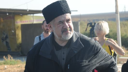 Refat Chubarov, chairman of the World Congress of Crimean Tatars, attends a protest
