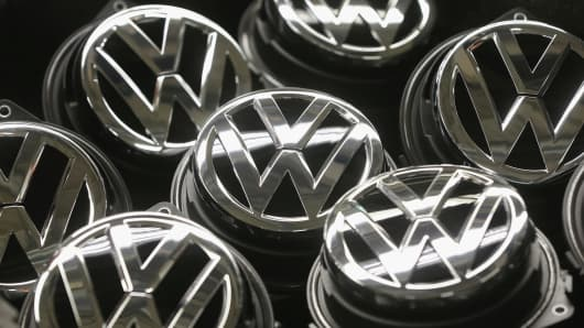 Volkswagen trunk ornaments bearing the VW logo lie next to the Golf VII assembly line at the Volkswagen factory in Wolfsburg, Germany.