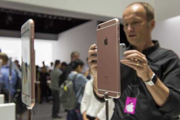 Attendees take photographs of the Apple Inc. iPhone 6s and iPhone 6s Plus smartphones after a product announcement in San Francisco, California.