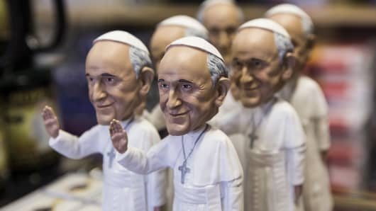A pope bobblehead is one of many Pope Francis-themed souvenirs for sale at White House Gifts before the pope's first official visit to the United States.