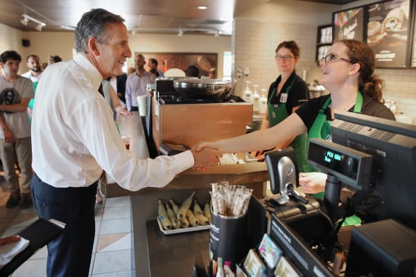 Starbucks CEO Howard Schultz greets employees at a Starbucks in Charleston, N.C.