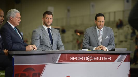 Anchor Kevin Negandhi (right) talks with Tim Tebow (center) and Mack Brown. File Photo.