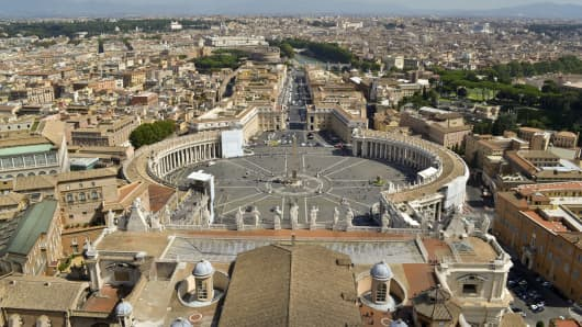 Saint Peter's Square in Vatican and aerial view of the city.