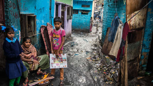 Slum dwellers lead their life in poverty and unhealthy conditions in New Delhi, India. The World Bank is set to raise the global poverty line.