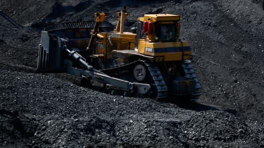 A Caterpillar Inc. D10R Crawler Tractor bulldozer moves coal at an Alpha Natural Resources Inc. coal preparation plant in Logan County near Yolyn, West Virginia.