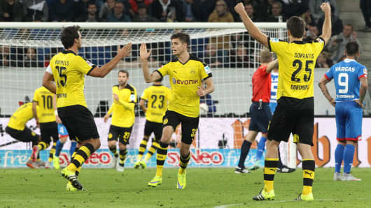 Dortmund's players celebrate during the German first division Bundesliga football match TSG 1899 Hoffenheim vs Borussia Dortmund in Sinsheim, on September 23, 2015
