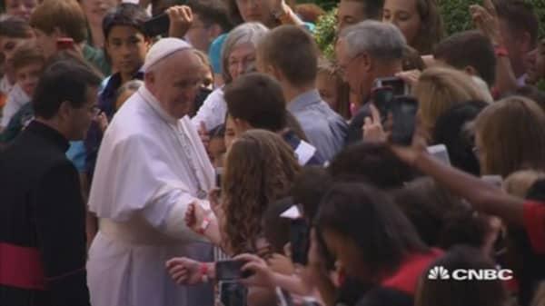 Bringing the pope brings the bucks