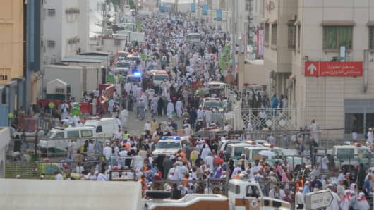 Ambulances are seen on a road after at least 753 Muslim Hajj pilgrims were killed and at least another 450 injured in a stampede that took place near the city of Mecca in Saudi Arabia.
