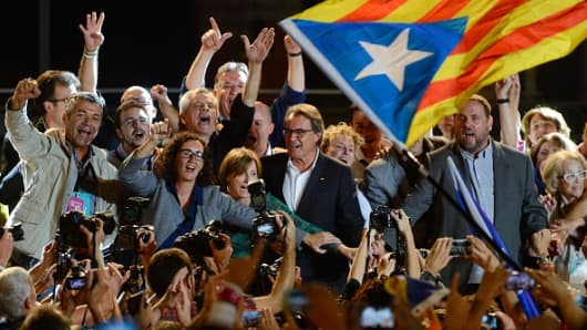 President of Catalonia Artur Mas (C) claimed victory in the regional election in Catalonia Sunday.