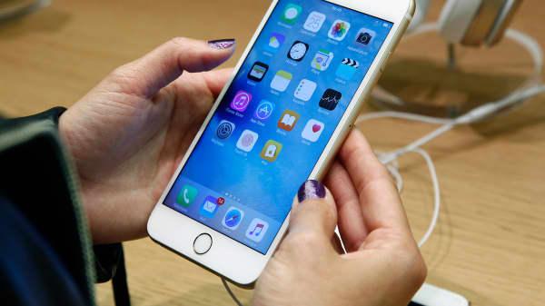 A customer checks an iPhone 6s at an Apple store.