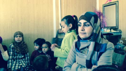 Asma'a Rashed in the trailer where she reads to kids each week at the Za'atari refugee camp in Northern Jordan