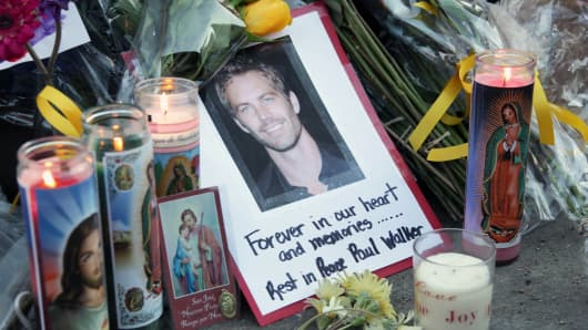 A general view of atmosphere as fans pay tribute to actor Paul Walker at the site of his fatal car accident on December 1, 2013 in Valencia, California.