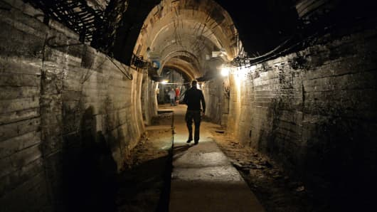 Men walk in underground galleries, part of Nazi Germany 'Riese' construction project under the Ksiaz castle in the area where the 'Nazi gold train' is supposedly hidden underground, on August 28, 2015 in Walbrzych, Poland.