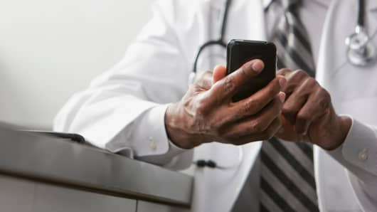 Doctor with mobile phone