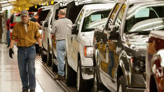 Ford F-150 trucks move along the assembly line as employees work at the company's Kansas City Assembly Plant in Claycomo, Missouri.