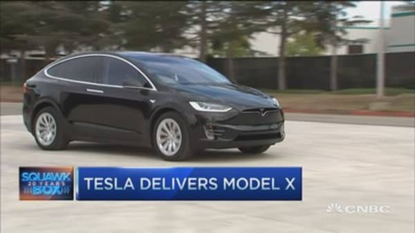 Tesla rolls out Model X with falcon wing doors