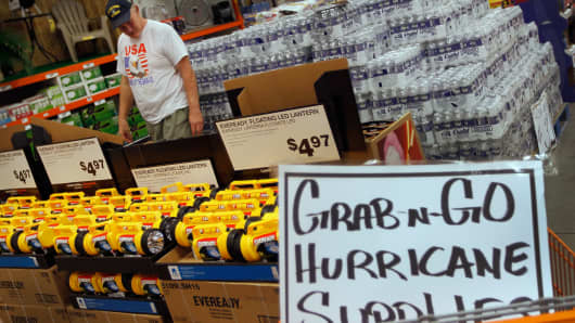 A customer shops for hurricane supplies at Home Depot as he prepares for the possible arrival of Hurricane Irene on August 22, 2011 in West Palm Beach, Florida.