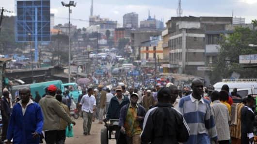 Kenyans throng a street in a Nairobi suburb.
