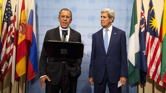 Russian Foreign Minister Sergei Lavrov (L) speaks during a news conference with United States Secretary of State John Kerry, at the United Nations headquarters in New York September 30, 2015.