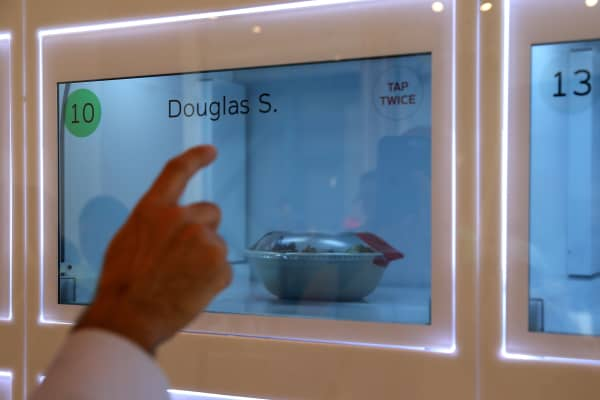 A customer picks up his lunch from an automated cubbie at eatsa, a fully automated fast food restaurant on August 31, 2015 in San Francisco.