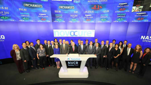 People from Novocure pose at the Nasdaq Market Site in New York, October 2, 2015.