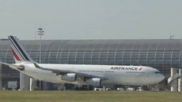 Air France workers storm managerial meeting