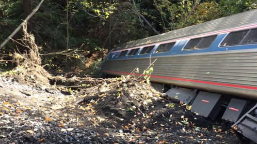 An Amtrak train derailed in Vermont. Four people were injured when two cars went over an embankment, according to the Montpelier Fire Department.