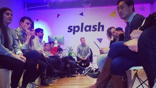 "A team of employees at ""Splash"" working in their New York City office."