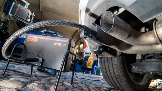 A measuring hose for emissions inspections in diesel engines sticks in the exhaust tube of a Volkswagen (VW) Golf 2,0 TDI diesel car at a garage in Frankfurt an der Oder, eastern Germany, on October 1, 2015.
