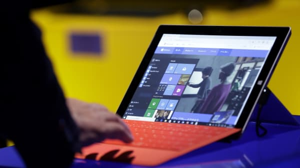 A visitor tries out Microsoft Windows 10 operating system on the Surface 3 tablet during a launch event in Tokyo, July, 2015.