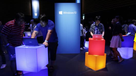 Visitors use laptop computers as they try out Microsoft Corp.'s Windows 10 operating system during a product launch event in Tokyo, Japan, on Wednesday, July 29, 2015.