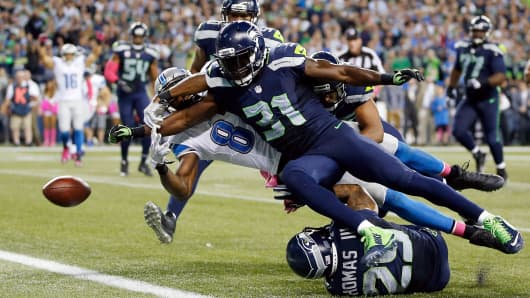 Kam Chancellor of the Seattle Seahawks forces Calvin Johnson of the Detroit Lions to fumble near the goal line during their game at CenturyLink Field on Oct. 5, 2015, in Seattle.