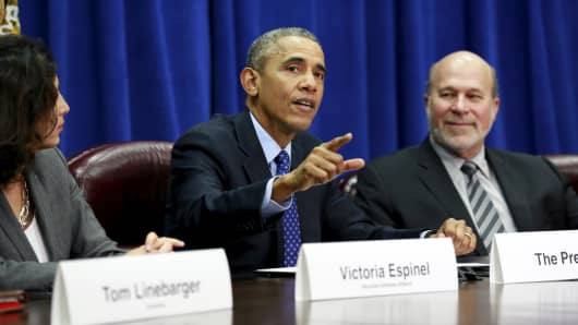 File photo: Barack Obama speaks during a meeting with agriculture and business leaders about the Trans-Pacific Partnership at the Department of Agriculture in Washington October 6, 2015.  At left is Victoria Espinel, CEO of The Software Alliance and at right is Bob Stallman, president of the American Farm Bureau.