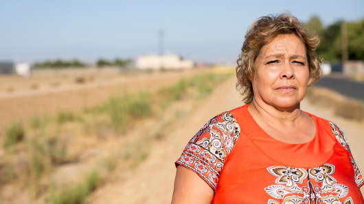 Sandra Garcia, a crew picker in the Central Valley, says drinking tap water sourced from a groundwater well makes her family sick.