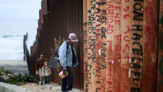A man walks along the U.S.-Mexico border wall on February 22, 2015 in Tijuana, Mexico. Senior Republican senators said they expected Congress will avoid a shutdown over the Department of Homeland Security, which faces a partial shutdown on February 27 over a GOP push to roll back President Barack Obama's executive actions on immigration.