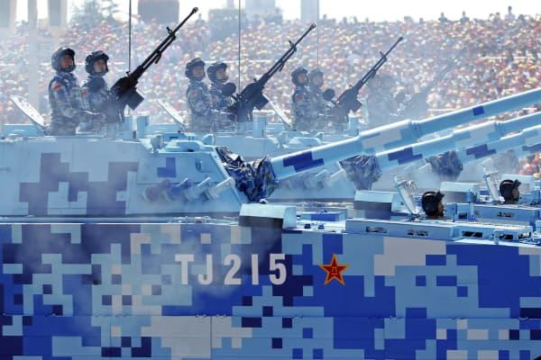 China's People's Liberation Army Navy (PLAN) soldiers roll on their armored vehicles to Tiananmen Square during the military parade marking the 70th anniversary of the end of World War II, in Beijing, Sept. 3, 2015.