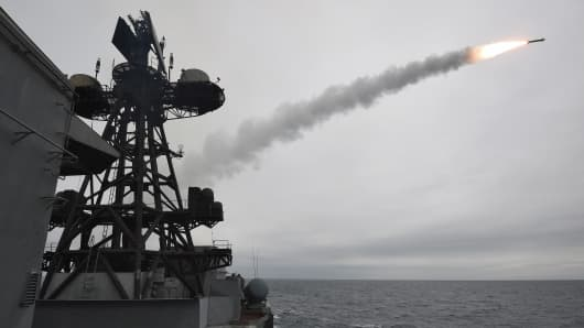 Start of a rocket from a warship board on Northern navy in Murmansk, Russia.