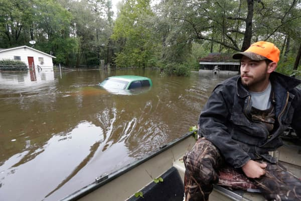 Hunter Baker surveys flood damage to his neighborhood near the flooded Black Creek following heavy rains in Florence, S.C., Oct. 5, 2015.