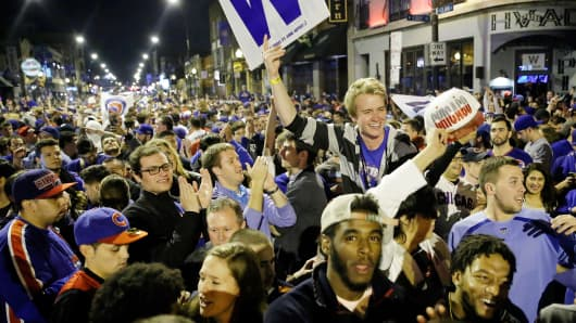 Fans take to Chicago streets to celebrate the Cubs' win in the National League Wild Card Game against the Pittsburgh Pirates on October 7, 2015.