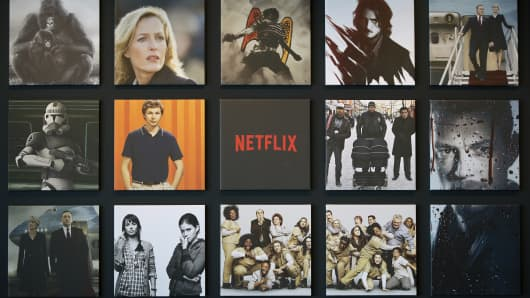 Promotional images of Netflix Inc. programs are displayed on a wall at the Netflix Japan office in Tokyo.