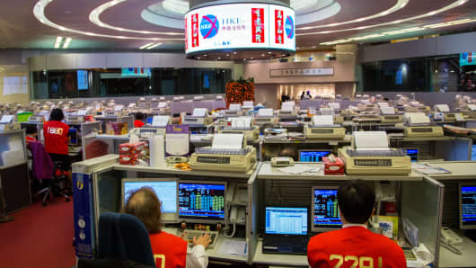 Traders work on the trading floor of the Hong Kong Stock Exchange on the first day of trading after Chinese New Year in Hong Kong, China, on February 4, 2014.